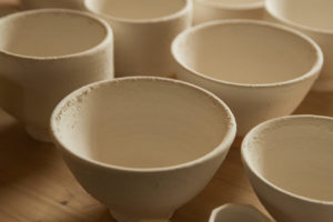 Glazed pots before they are placed in the kiln