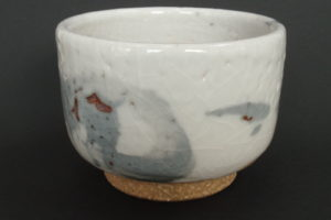 Feldspar shino glaze on coarse kaolin clay, ochre underglaze brush decoration